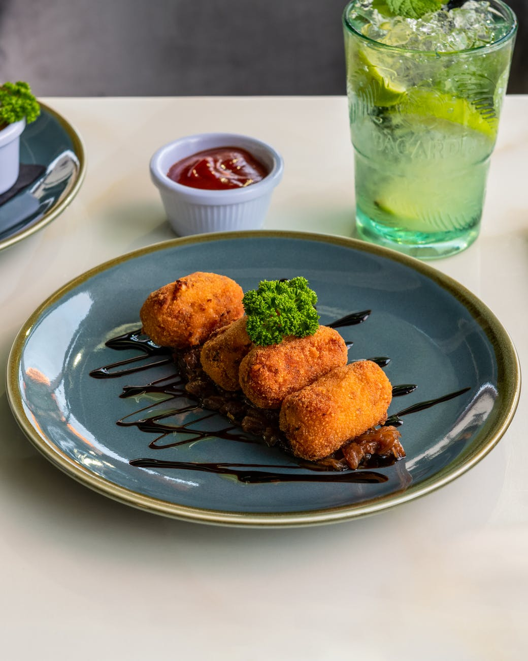 fried croquettes on blue ceramic plate